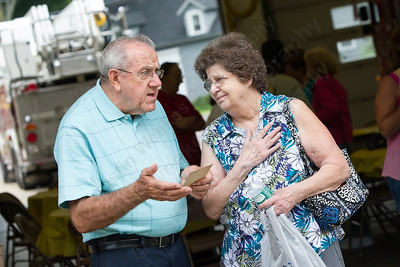Al Ingriselli and Sandra Kelly both of Southington talk Saturday for the Milldale School Reunion at Engine Company 3 on Clark Street in Milldale Jul. 18, 2015   Justin Weekes / For the Record-Journal