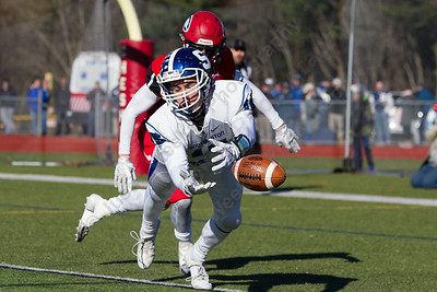 Southington's Timothy O'Shea dives for a pass Thursday during the 22nd Annual Apple Classic on Thanksgiving Day at Alumni Field on the campus of Cheshire High School in Cheshire. The Blue Knights of Southington defeated the Cheshire Rams 30 to 22. November 23, 2017 | Justin Weekes / For the Record-Journal