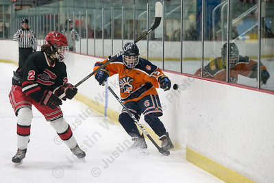 Lyman Hall's TJ Arduini keeps the puck in the zone Tuesday at the Northford Ice Pavilion in Northford December 19, 2017 | Justin Weekes / For the Record-Journal