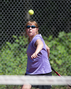 Justine Hoover eyes a fore hand shot in the high school girls final with Julia Migliorini Sunday during the Wint Filipek Sr. Tennis Tournament held at Copper Valley Club in Cheshire Jun. 14, 2015 | Justin Weekes / For the Record-Journal