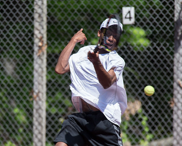 Roy Smith returns a serve from Ron Goodman in he mens A single final  Sunday during the Wint Filipek Sr. Tennis Tournament held at Copper Valley Club in Cheshire Jun. 14, 2015 | Justin Weekes / For the Record-Journal