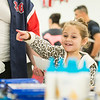 Madison Foley, 6, of Attleboro points at the school supplies she wants at LHAND's Back to School Bash.