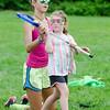 Coach Callie O'Neill gives instructions to kindergarten Violet Pierce.