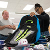 Marie Quezada, 16, of Danvers picks out a new backpack with her step-father Bruce Sweeter of Danvers during LHAND's Back to School Bash.