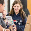 Adrianna Quartochi, 12, of Fall River holds a binder and notebooks that she picked up at LHAND's Back to School Bash for veterans, military families, and Gold Star families on Tuesday.