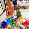 Lisa Pilat and her son Maddoc, 10, both of Dedham, choose notebooks for back to school at LHAND on Tuesday.