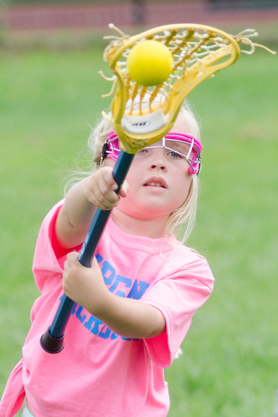 Winnie Huddleston, a kindergarten, practices tossing the ball.
