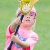 Winnie Huddleston, a kindergarten, practices tossing the ball.