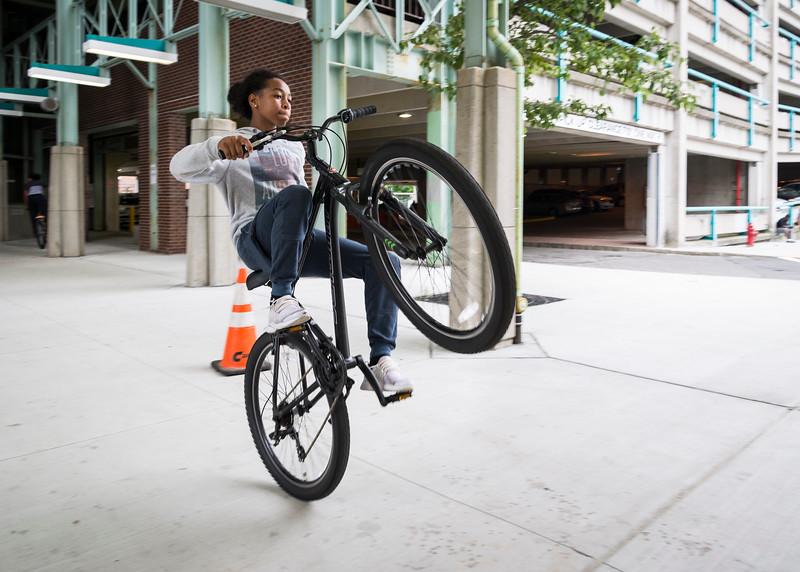 Miguel Segura, 14, of Lynn pops a wheelie as he rides his bike through the MBTA parking garage in Lynn.