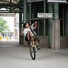 Zion Sams, 17, of Lynn pops a wheelie as he rides his bike through the MBTA parking garage in Lynn.