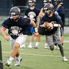 08/18/2017. Lynnfield football practice. Quarterback Matt Mortellite runs with the ball behind Anthony Murphy.