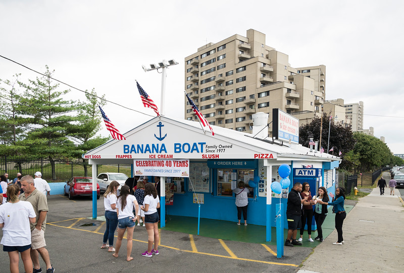 State and city officials, friends, family, and patrons gather at Banana Boat in Revere to celebrate 40 years of operation for the ice cream stand.