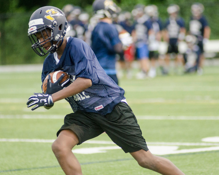 08/18/2017. Lynnfield football practice. Anthony Hunt carries the ball.