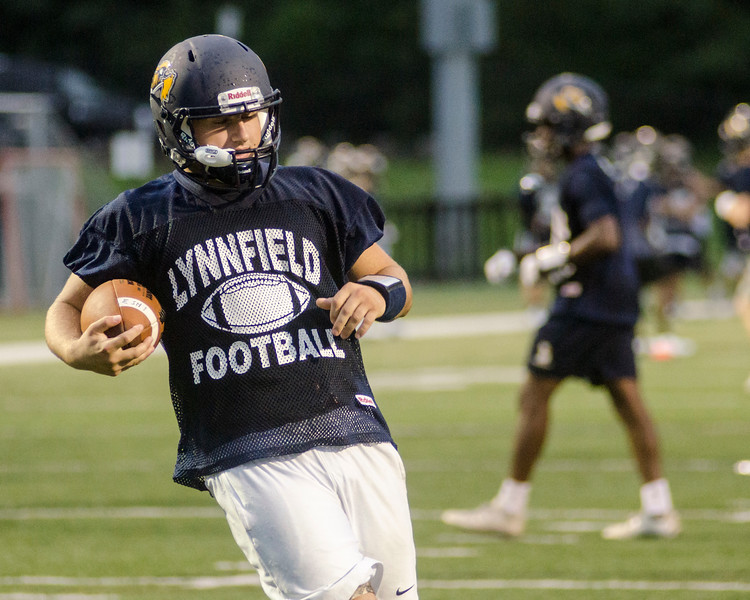 08/18/2017. Lynnfield football practice. Anthony Murphy carries the ball.