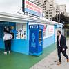 Revere Mayor Brian Arrigo, right, walks past Banana Boat ice cream on Friday before celebrating the businesses 40 years of operation.