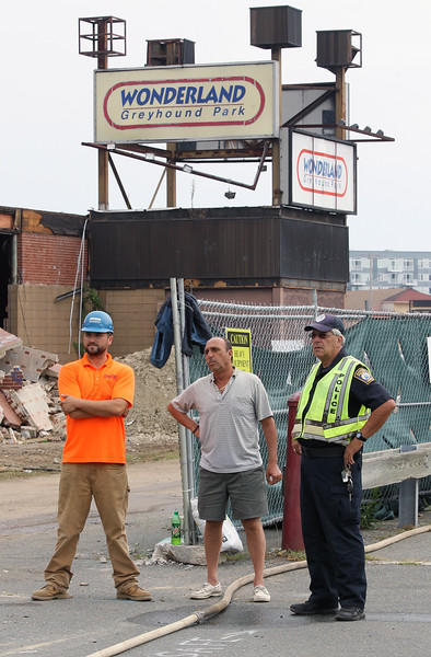 Revere, MA--Friday Aug 18, 2017--[l-r] Tim Carr, Site Manager for Plumb House, the company demolishing Wonderland Greyhound Park, Joe Maglione, Revere Dir. Water and Sewer, and Revere Police Patrolman Ralph DiPasquale watch the demolition team begin work on the demolition of Wonderland Greyhound Park.<br /> <br /> Daily Item Staff Photo/Jim Wilson