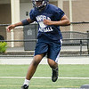 08/18/2017. Lynnfield football practice. Jason Ndansi hops over obstacles in a drill.