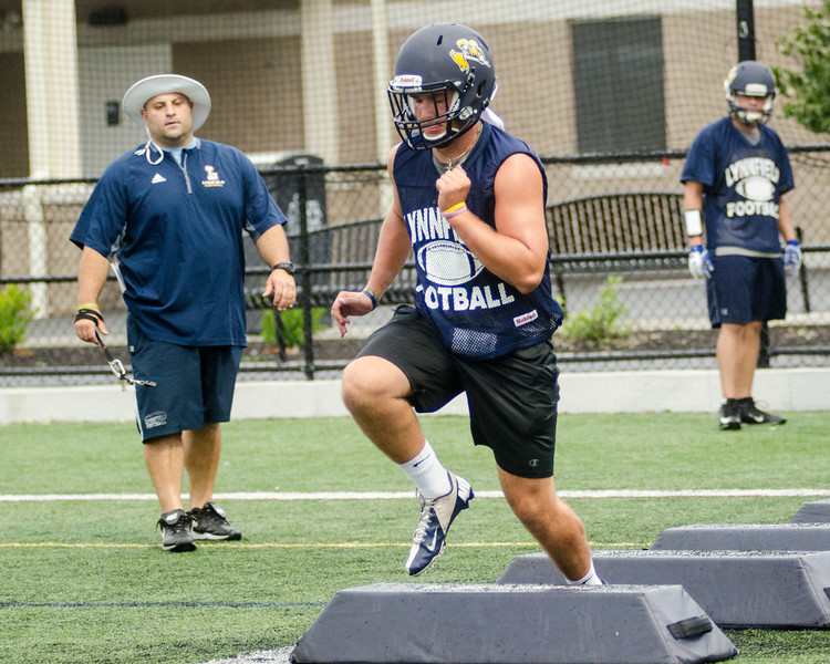 08/18/2017. Lynnfield football practice. Cooper Marengi hops over obstacles during a drill.