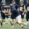 08/18/2017. Lynnfield football practice. Brett Cohee, left, hands off the ball to Anthony Murphy.
