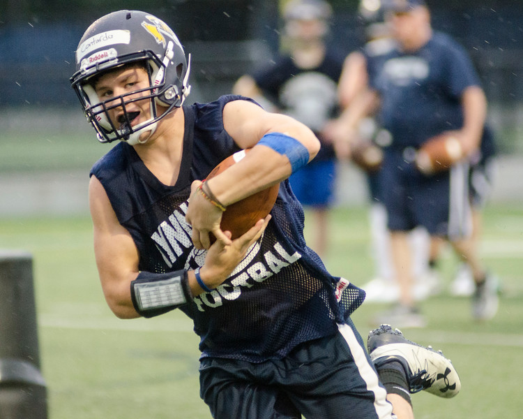 08/18/2017. Lynnfield football practice. Jack Contardo carries the ball after a catch.
