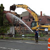 Revere, MA--Friday Aug 18, 2017--Revere Fire department Lt. Joseph Placet hoses down the area where a demolition team from a company called Plumb House begins work on the demolition of Wonderland Greyhound Park.<br /> <br /> Daily Item Staff Photo/Jim Wilson