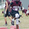 08/18/2017. English football practice. Tahj Purter hops over pads during a drill.
