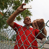 """Revere, MA--Friday Aug 18, 2017--Revere resident Clifford """"Cliffy"""" Pisano takes a photo of a demolition team from a company called Plumb House as they demolish a building at Wonderland Greyhound Park. Pisano said the building being torn down is the first place he ever filled out a job application when he was young.<br /> <br /> Daily Item Staff Photo/Jim Wilson"""