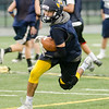08/18/2017. Lynnfield football practice. Nick Kinnon tries to slow up after catching a pass.