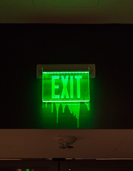 """The exit sign for the """"It's Alive!"""" gallery at the Peabody Essex Museum fits right into the theme of the classic horror and sci-fi art show."""