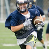 08/18/2017. Lynnfield football practice. Colby Clattenberg runs with the ball.