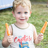 Solomon Martell, 2, of Nahant holds up his popsicles he got at the back-to-school slush and popsicle party at Johnson School.