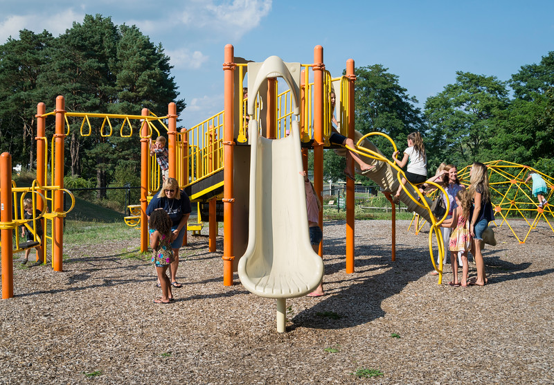 Kids play on the jungle gym at the Johnson School in Nahant during the back-to-school slush and popsicle party on Tuesday.