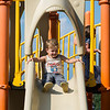Solomon Martell, 2, of Nahant gets ready to slide at the playground at the Johnson School.