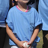 Peabody, Ma. 9-4-17. Olivia Silva, who is suffering from cancer, with the ball she threw out  as a souvenir at the 61st annual Peabody and Lynnfield charity baseball game at Emerson Park in Peabody to raise money for cancer research.