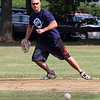 Peabody, Ma. 9-4-17. Richie Rose fields a ball on the first base line in the 61st annual Peabody and Lynnfield charity baseball game at Emerson Park in Peabody to raise money for cancer research. Richie's father was one of the founding members of this event 61 years ago.