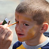 Peabody, Ma. 9-4-17. Jackson Fagundes having his face painted as a tiger at the 61st annual Peabody and Lynnfield Charity Baseball game at Emmerson Park in Peabody to raise money for cancer research.