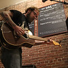 Lynn, Ma. 9-28-17. Guitarist/singer Joe Skahan performing at the hurricane relief fundraiser for Puerto Rico held at the White Rose Coffeehouse in Lynn.