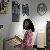 Lynn, Ma. 9-28-17. Lynn English High School student Mandy Healey looks at the A Potrait of Lynn exhibit in the foyer at the library at Lynn English High School.