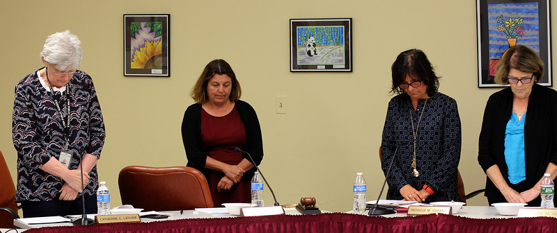 Lynn, ma. 9-28-17. Lynn Superintendent Dr. Catherine Latham, Mayor Judith Flanagan Kennedy, School Committeeman Patricia Capano and School Committeeman Lorraine Gately during a moment of silence that included Venessa MacCormack to start this week's meeting.