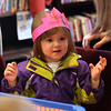Abigail Otto tries on the crown she just finished making at the noon years eve celebration at the Saugus Library today. Photo by Owen O'Rourke