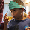 Jack Cuddy got the opportunity to try some fake champagne at the noon years eve celebration at the Saugus Library today. He said it tasted like orange juice. Photo by Owen O'Rourke