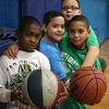 Basketball is a staple at the Boy's and Girl's Club in Lynn, and Jordin Liz, Howard Guerrero, Brian Fajardo and Matthew Julio play all the time. Photo by Owen O'Rourke
