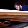 Will Alderfer loads lumber onto the back of his truck at the Lynn Lumber liquidation on Monday, January 13. Item Photo / Angela Owens.