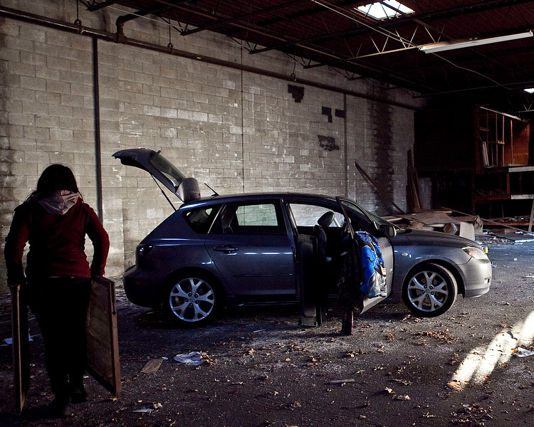 Angela Anthony puts glass windows into the back of her car during the Lynn Lumber Company liquidation on Monday, January 13. Item Photo / Angela Owens.