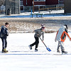 Lynn, Flax Pond.  Three friends prepare to have an ice hockey game on the Pond.<br /> lft to rt: Chris Coyne, Nicholas Kosmas, and Trey Dow.  Nicholas is shovelling the snow off the ice.