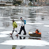 Lynn, Flax Pond.  The end of the Ippi's Kick -Off Ice Derby.<br /> lft. Ryan Spaulding, Lynn and rt. Marc Lecouras, Saugus, head across the ice toward shore at the end of the  Ippi's Kick-Off Ice Derby tournament at noon on Sunday.