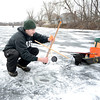 Peabody, Brown's Pond. Ice Fishing.<br /> Spencer Rancourt, Lynn, sets a trap for fish during a fishing expedition on Sunday.