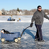 Lynn, Flax Pond, open skating.<br /> Adam Carritte, Lynn, pulls a wagon holding his daughter Riley, aged 2, who was fast asleep.