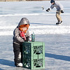 Lynn, Flax Pond, open skating.<br /> Delaney Carritte, aged 4, works her way around the ice using crates.