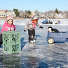 Lynn, Flax Pond, open skating.<br /> lft to rt: Joslin Sabino,  Delaney Carritte, and Riley Carritte, asleep in wagon. All Lynn.
